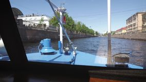 View of Neva river in St. Petersburg, Russia. Tourist boats float on the river. Buildings near the Neva River Embankment stock video footage