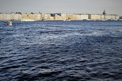 A view at Neva river. A view at blue water of Neva river and the buildings behind royalty free stock images