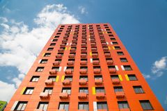 View of the new beautiful orange and white apartment building on a bright Sunny day. royalty free stock images