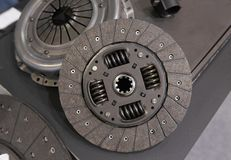 View on new clean car truck clutch component part detail. Car clutch disc disk parts details components for maintenance repair Car. Clutch disc spare parts stock photos
