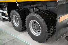 View on new clean rear tipper truck wheels and tires. Mud wheels for commercial transport, special cars. Truck chassis with wheels. Heavy truck stock images