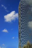 View of new highrise office building against blue sky with cloud reflections Stock Photos