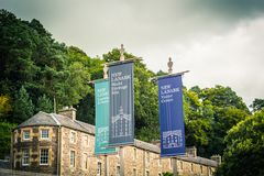 View of New Lanark Heritage Site, Lanarkshire in Scotland, United Kingdom. With red phone box Stock Photos