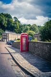 View of New Lanark Heritage Site, Lanarkshire in Scotland, United Kingdom. With red phone box Stock Photography