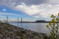 View of new stadium `Zenith Arena` and new cable-stayed bridge from Neva River, St. Petersburg, Russia stock photography