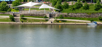 A View Of The New Urban River Front. Awnings and pathways on the new urban river front area in Pittsburgh with a powerboat docked Royalty Free Stock Photography