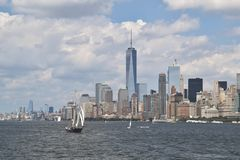 A view of New York City with a sailing ship at the forefront, USA. A view of New York City with a sailing ship at the forefront viewed from the Staten Island stock photography