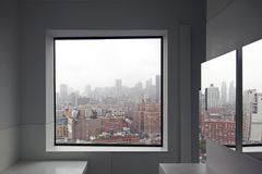 A view of New York City skyline from a window and a reflection on the mirror.  royalty free stock photo
