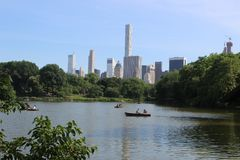 A view of New York from The Lake in Central Park stock image