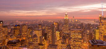 The view of new york manhattan during sunset hours Stock Photos
