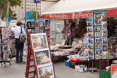 View of newsagent stall selling. Barcelona, Spain-May 27, 2013: View of newsagent stall selling newspapers, magazines and tourist souvenirs on the famous Las royalty free stock image
