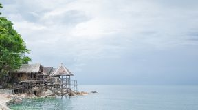View of nice bungalow on  tropical empty sandy beach Royalty Free Stock Photography