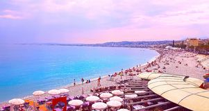 View of Nice city, Beach at sunset, Promenade des Anglais, Cote d`Azur, French riviera, Mediterranean sea, France.  royalty free stock image