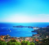 View of Nice, Villefranche-sur-Mer, Cape Cap-Ferrat on a bright sunny day. Cote d`Azur, French Riviera, France royalty free stock photography