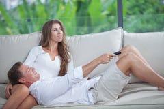 Couple on sofa Stock Image