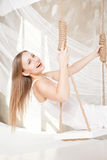 View of nice young lady swinging  in studio Royalty Free Stock Photo