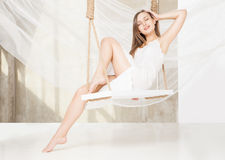 View of nice young lady swinging  in studio Royalty Free Stock Photos