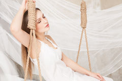 View of nice young lady swinging  in studio Stock Photos