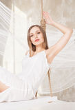 View of nice young lady swinging  in studio Stock Images
