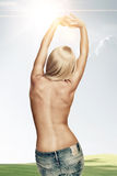 Sun shine back. View of nice young wonam back on color back Royalty Free Stock Image