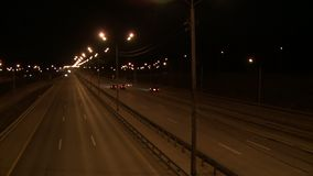 View of a night city road. With cars passing by stock video footage