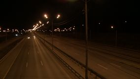 View of a night city road. With cars passing by stock footage