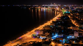 View of night city shore in lights with coast road traffic. Panorama of night resort city shore in lights with coast road traffic and sea reflections stock footage