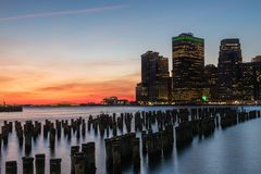 View of the night city at sunset. Glowing lights of skyscrapers. View of the city of New York and the bay. New York. Long light exposure stock image