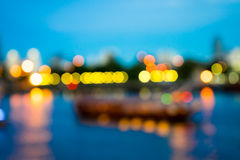 View of night light blur with reflection light in water Stock Images
