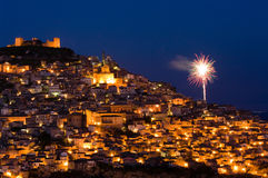 View by night old italian village with fireworks Stock Photos