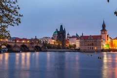 View of night old town of Prague and Charles bridge with reflection in Vltava River Royalty Free Stock Photos