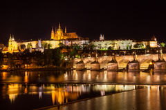 View at night over the RiverVltava with Charles Bridge and the C Stock Image