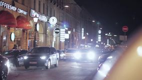 View of night road in city. Driving cars with turn left signals. stock video footage