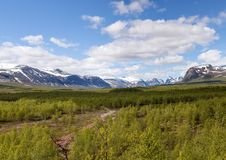 View from Nikkaloukta towards Sweden`s highest mountain range with Kebnekaise as the highest peak. You can see Toulpagorni, Singicokka and Ciervracohkka among Royalty Free Stock Images