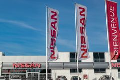 View of the Nissan brand logo on the flags. LOMME,FRANCE-February 17,2019: View of the Nissan brand logo on the flags.Nissan is a Japanese international car stock photo
