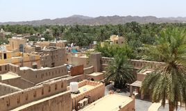 View of Nizwa, Oman. View of the historical town of Nizwa from the top of Nizwa Fort in central Oman Stock Photo