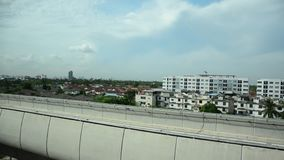 View of Nonthaburi city from MRT Purple Line skytrain stock video footage