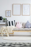 View of nordic sofa. View of wooden nordic sofa in trendy children`s room Royalty Free Stock Photography
