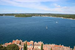 View north from the bell tower of Saint Euphemia church to northern part of Rovinj Rovigno on the Istrian peninsula in Croatia w. Ith red tiled roofs of houses royalty free stock photos