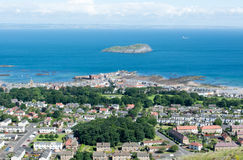 A view of North Berwick and the island Ailsa Craig from the Nort. North Berwick town and Ailsa Craig Island taken from North Berwick Law on a sunny day Stock Photos