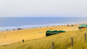 A view of the North Sea beach, autumn, with blue water and yellow grass stock images