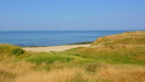 View on the North sea from the dunes along Opal coast. View on the blue north sea from the dunes along Opal coast on a sunny summer day in Pas de Calais, France stock photo