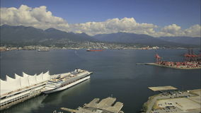 View of North Vancouver BC Canada with Water Transportation View of Mountain and Moving Clouds stock video