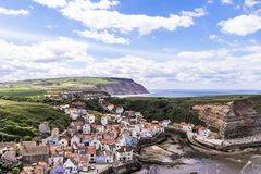 A view of the North Yorkshire UK villages of Staithes and Cowbar, seen here from from Penny Nab headland. A view of the North Yorkshire UK villages of Staithes stock image