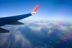 View from Norwegian airplane window with blue sky and white clouds. 08.07.2017 Palma de Mallorca, Spain. View from Norwegian airplane window with blue sky and Stock Photography