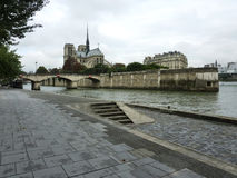 View of Notre Dame. From the riverbank of Seine River in Paris, France during autumn Stock Photo