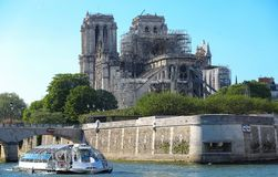 The view of Notre Dame cathedral without roof and spire destroyed by the fire , Paris.