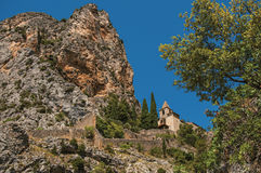 View of the Notre-Dame de Beauvoir church amidst cliffs and rock stairway. stock photos