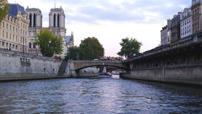 View of Notre Dame de Paris Cathedral. Paris, France - October 25, 2015 : View of Notre Dame de Paris Cathedral from sightseeing ship in Seine River at Paris stock video