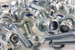 Metal Mechanical fastener screws and nuts. A view of nut,bolts and washers royalty free stock image